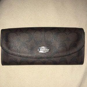 coach brown monogrammed wallet, pink interior